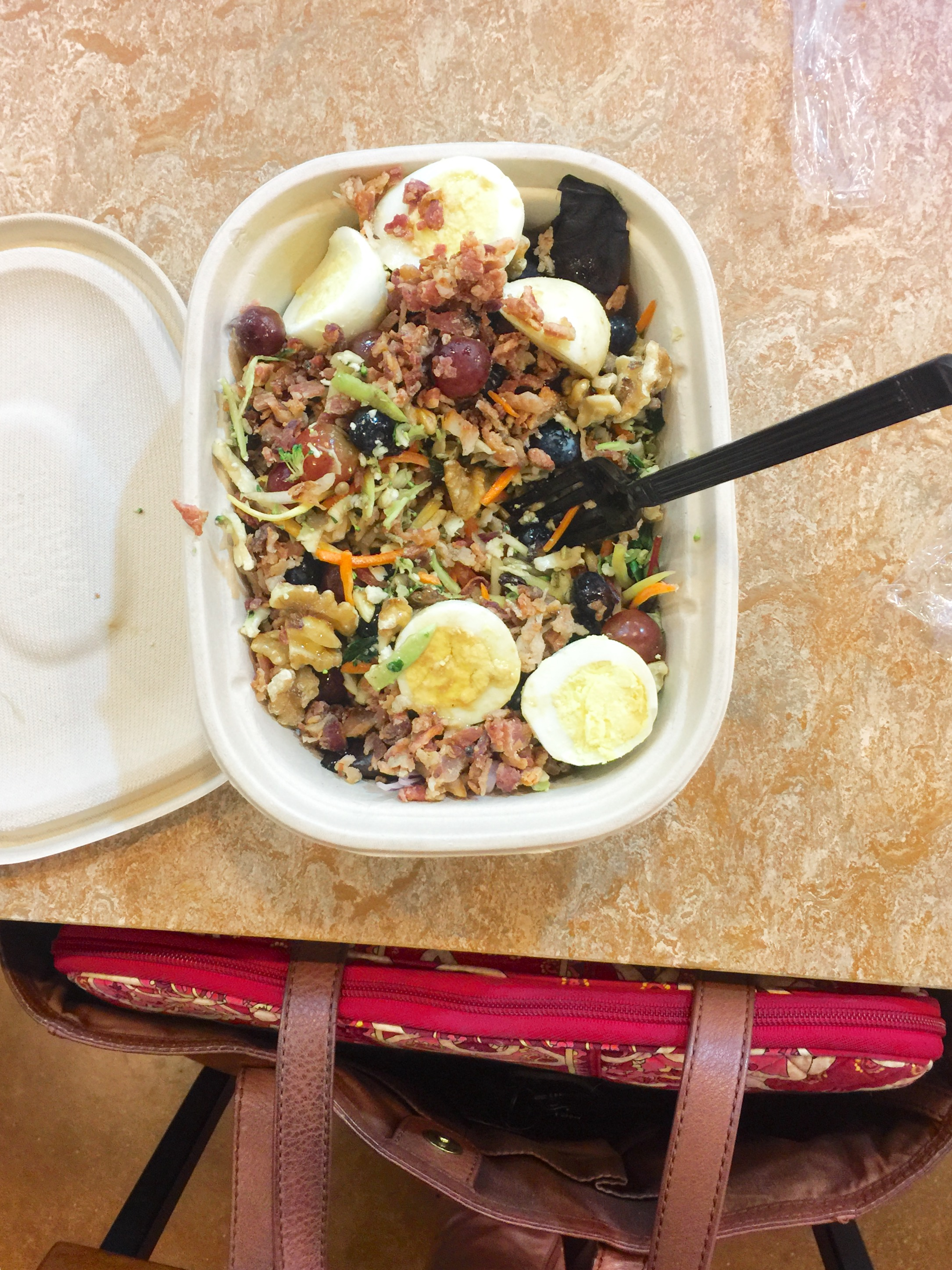 Whole Foods salad bar concoction (grapes, lettuce, blueberries, detox salad, shredded carrots, red onion, hard boiled eggs, and bacon with vinegar and olive oil