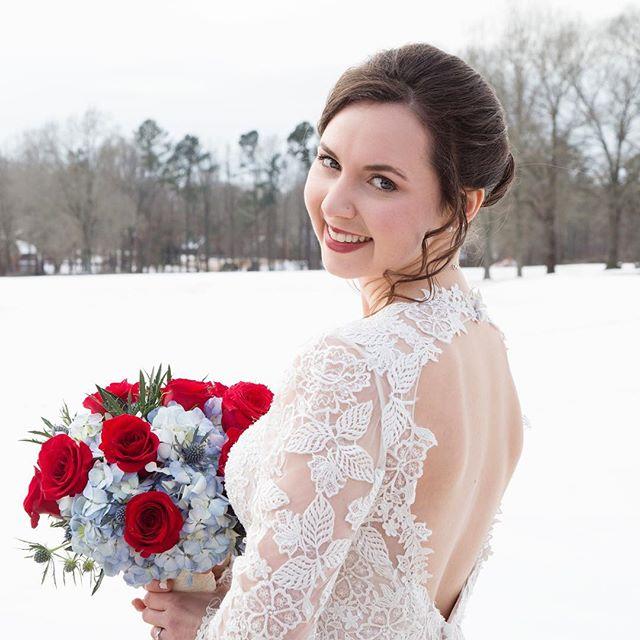 Whitney in a winter wonderland on her wedding day. #wedding #weddingday #weddingphotography #weddingphotographer #memphiswedding #memphisnationalgolfclub #memphisweddingphotography #memphisweddingphotographer #bouquet #bride #winterwedding #snow