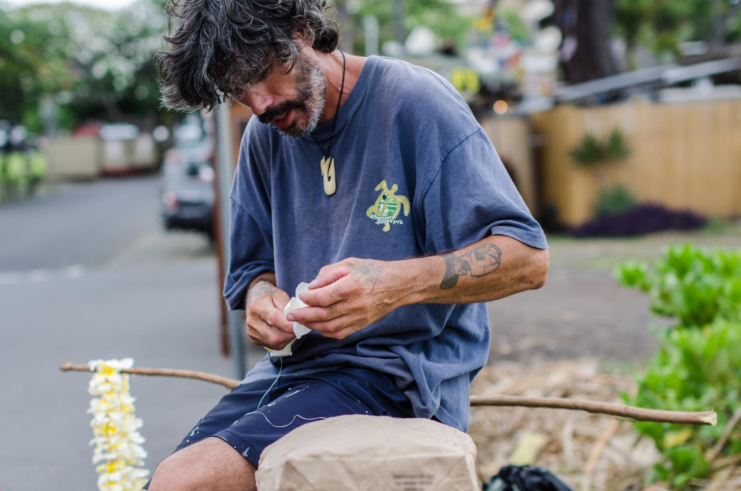 One of many local artists who line the streets of Kailua Kona.
