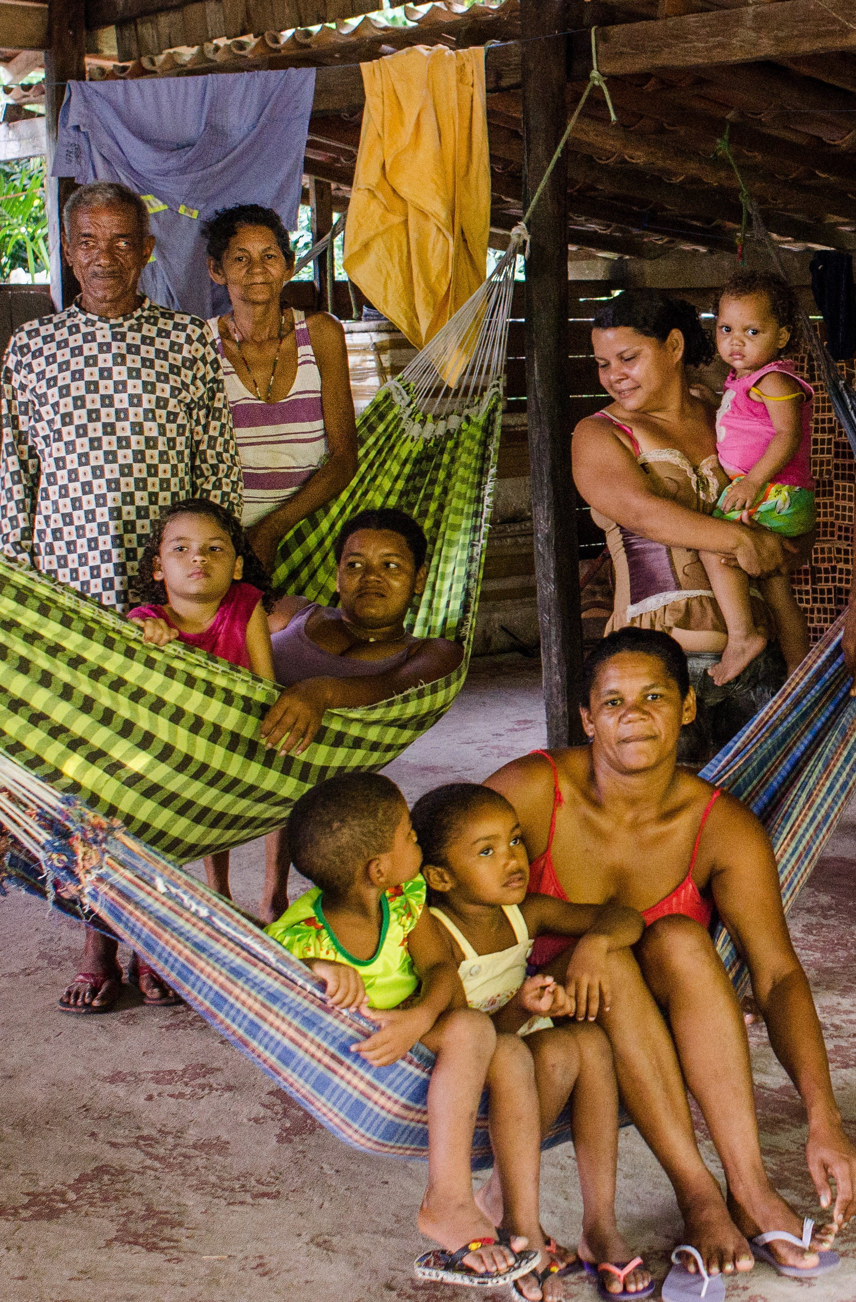 A handful of the family members who live with Uncle Black and Neuze. These are the hammocks they string up at night to sleep in, or lounge in during the day.