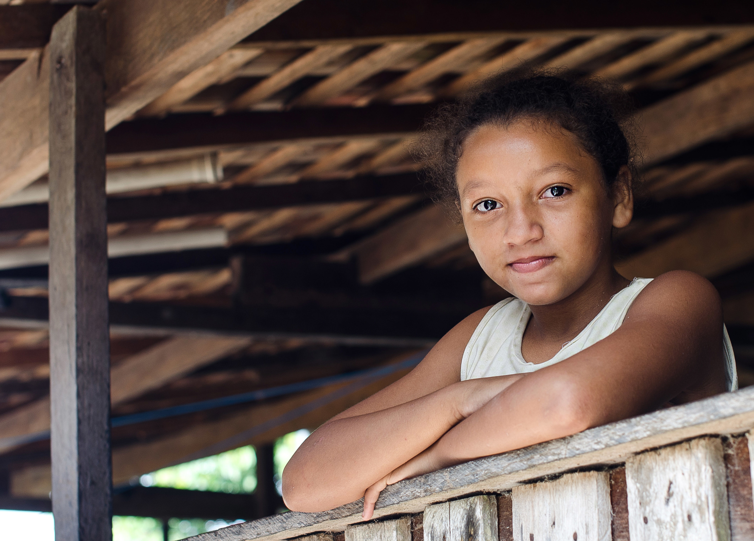 One of the many children who live in their home, presumably a grandchild.