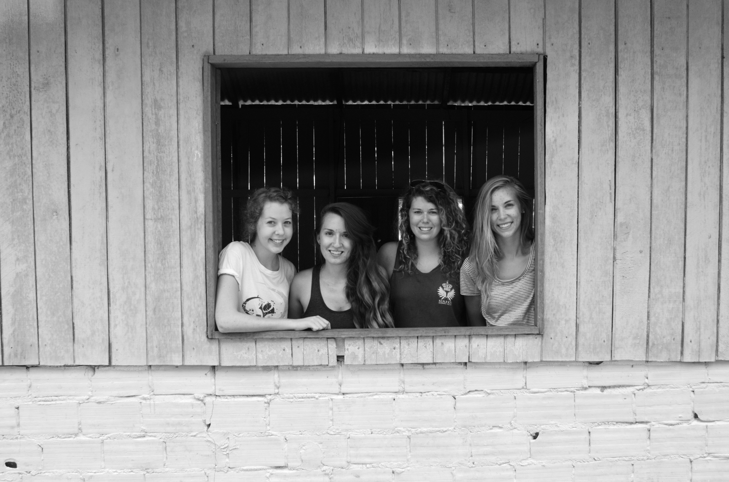 Joy, me, Heather, Natasha- posing in a village church window. This place will always be remembered for it's plumbing...