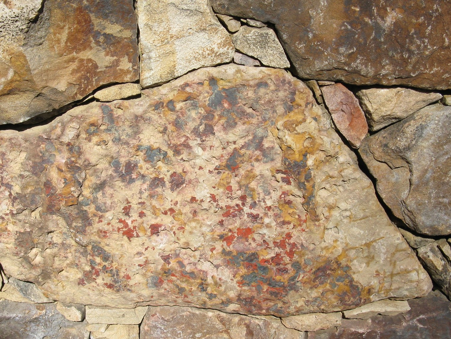 This colorful fieldstone, used in a retaining wall, has a painterly quality.