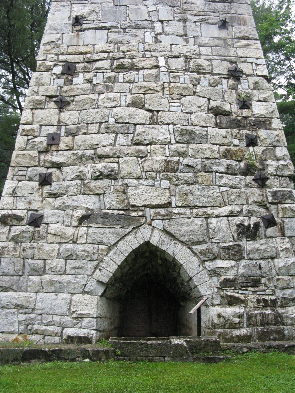 Tuyere arches are found on three faces of the furnace.