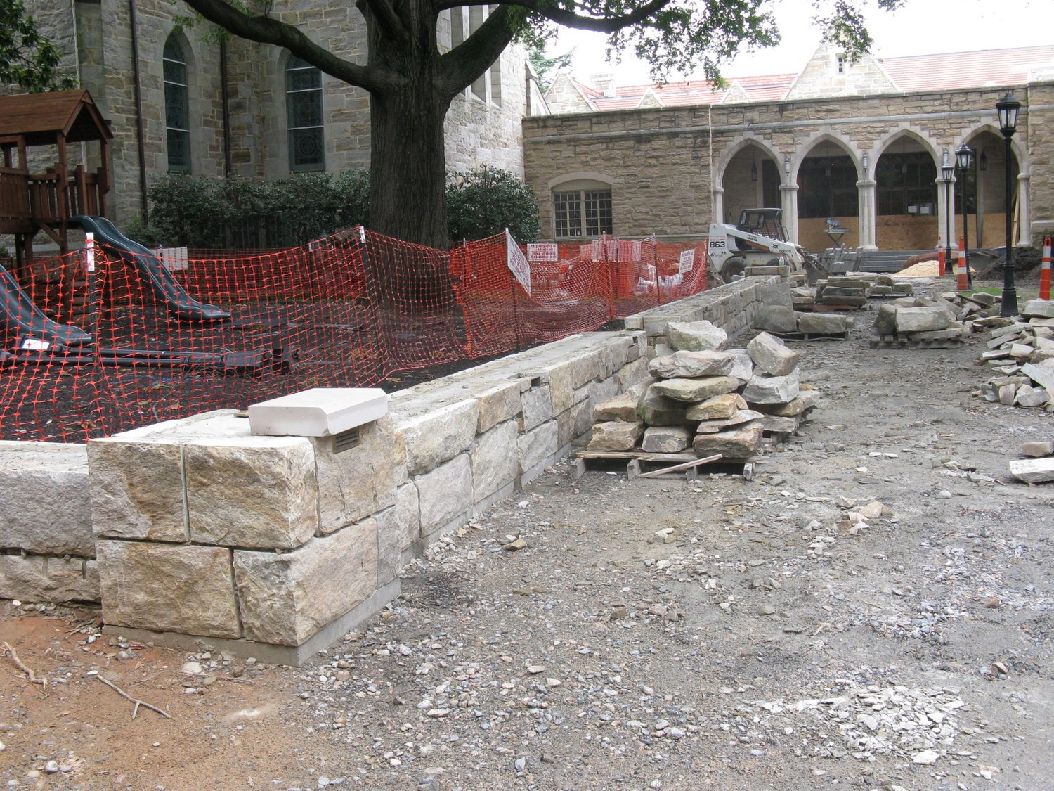 Constructing the stone wall around the above-ground footing