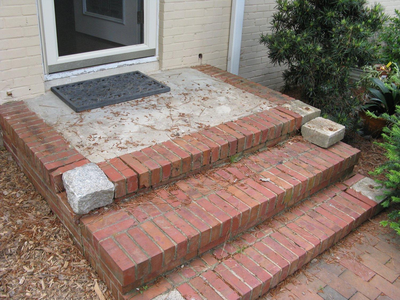 Brick and concrete porch before the makeover