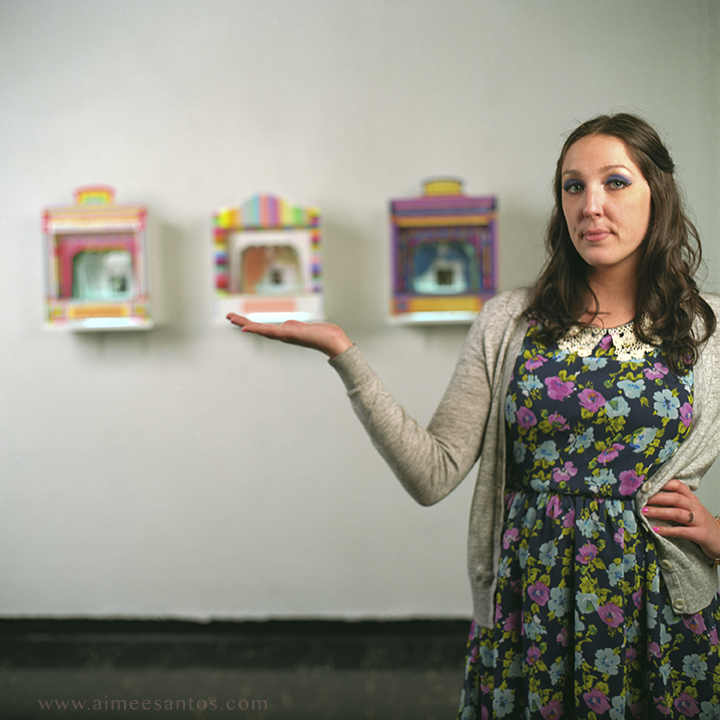 Standing in front of her paper theaters, Lindsay Montgomery lives and breathes the color she paints. Photo © Aimee Santos