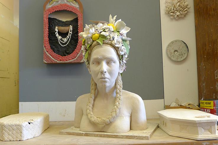 "'California Bloom' Stoneware, Porcelain, Wire, 32""x20""x15"" in front of 'The Rhythm: Birth' Stoneware, Gold Leaf 27""x14""x5"". Photo © Aimee Santos"