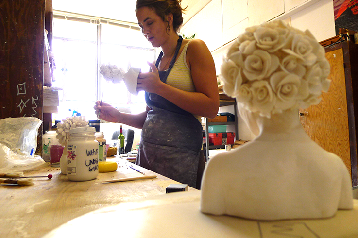 Malia Landis at work in her studio creating a series of head busts for her Thesis project that she earned at San Jose State University.  Photo © Aimee Santos