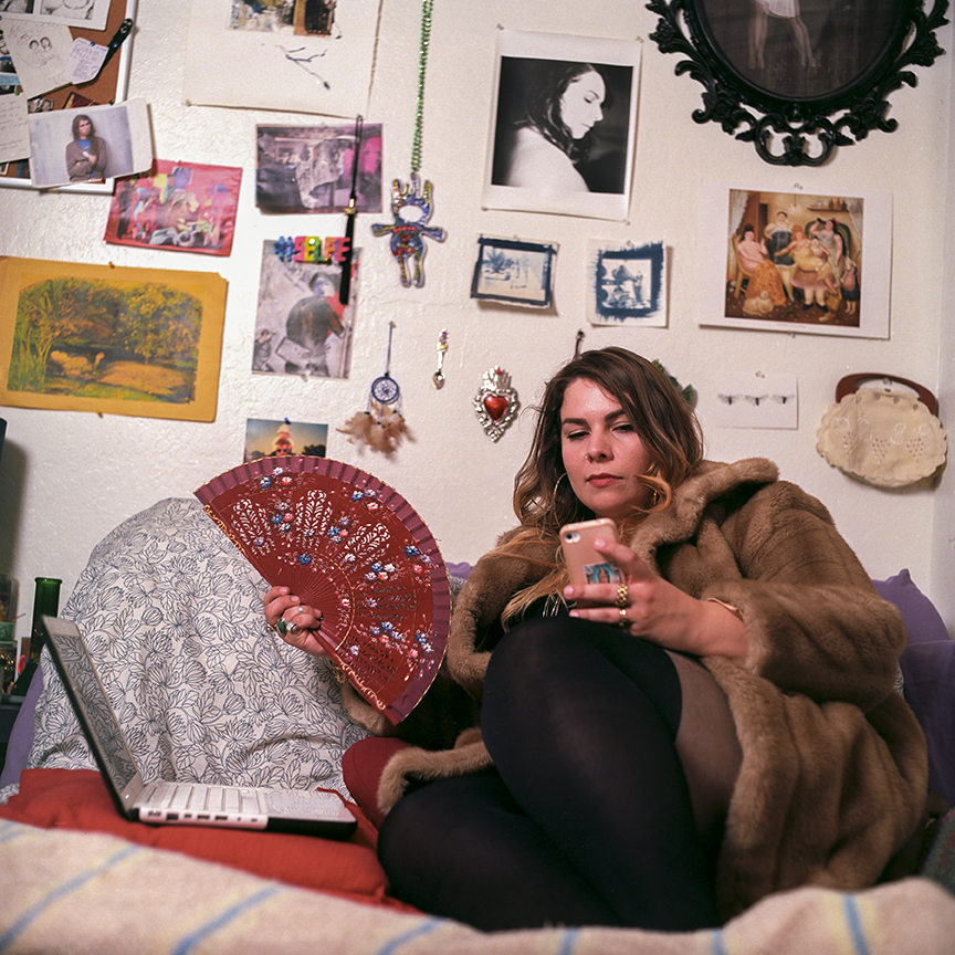 Laptops, cell phones and fur coats.  Nothing is ordinary in Cetto's life.  Photo © Aimee Santos