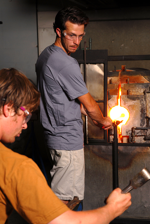 Teamwork is imperative in glass blowing.  One cannot accomplish one's goals without the help and assistance of another.  Photo © Aimee Santos