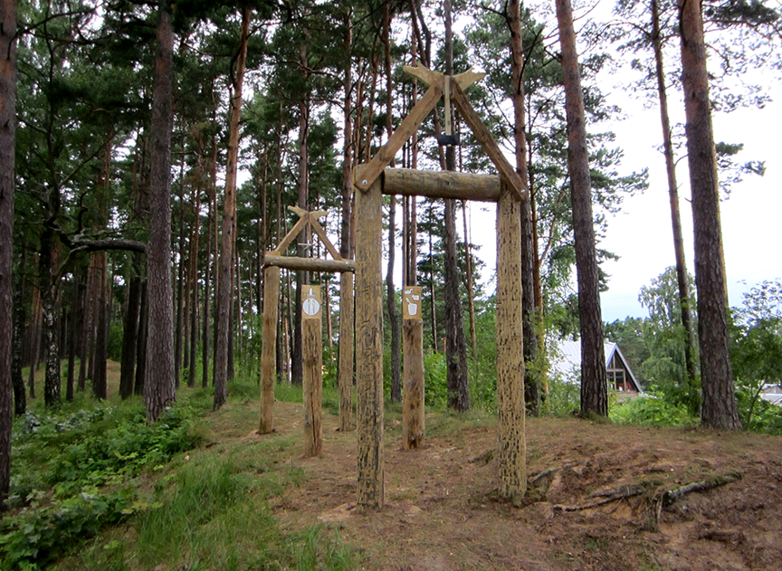 """Rest Stop for the Lost Souls of Latvia,"" Salvaged utility poles, salvaged lumber, steel hardware, paint, spiritual compassion.  2013"