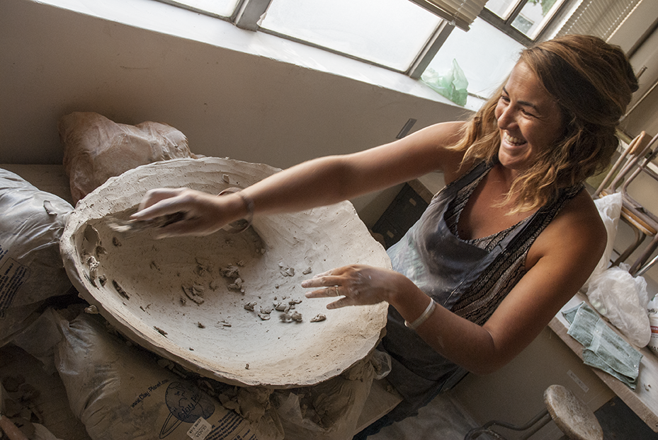 Malia Landis works on a commission piece of one of her Abalone shells that is part of her side business Salt and Earth and Sky. CLICK THE IMAGE to view her Abalone creations. Photo © Aimee Santos