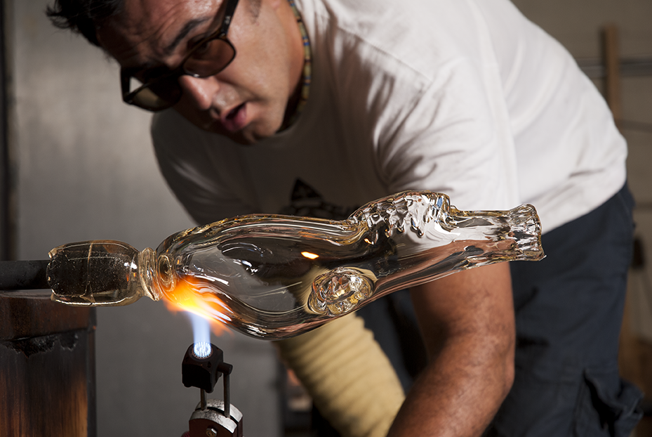 To keep the glass hot and pliable while outside the furnace, Guerrero torches the deer skull throughout the sculpting process at Revolution Glass in El Segundo, CA.  Photo © Aimee Santos