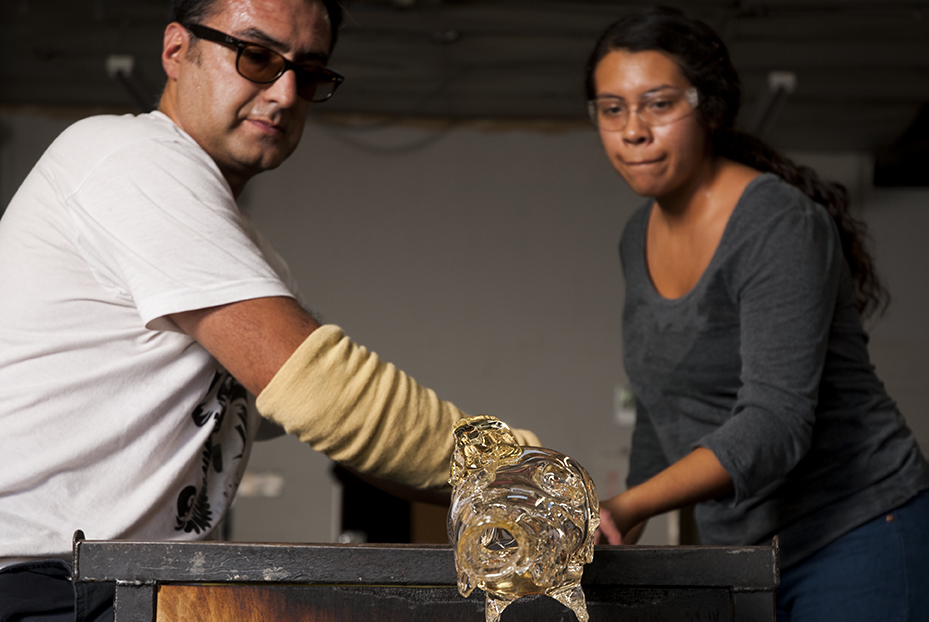 Alejandra Teyura, who has been working with Guerrero for three years,assists Jaime Guerrero during the creation of a deer skull at Revolution Glass in El Segundo, CA. Photo © Aimee Santos