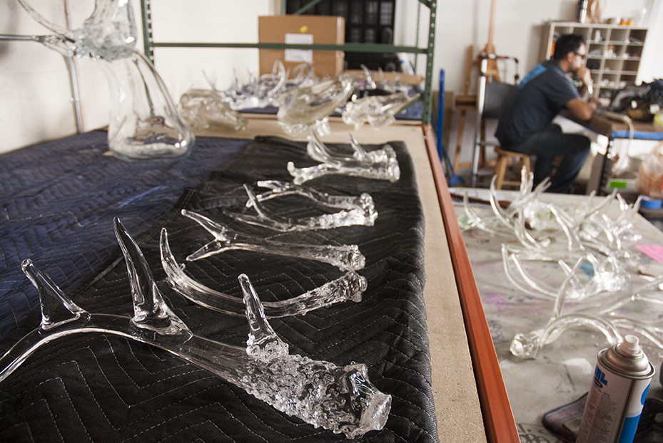 Antlers are laid out at Guerrero's studio in Boyle Heights where he works on his creations after first blowing them at a nearby Glass shop.  Photo © Aimee Santos