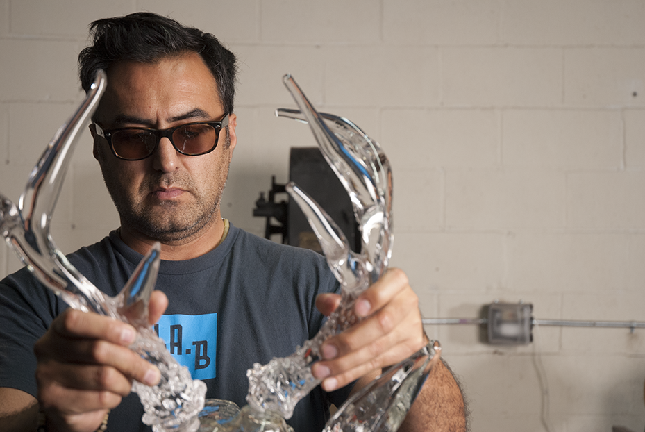 Guerrero works into the night on his upcoming show ' Cervidae: Open Season' showcasing multiple deer 'busts' all meticulously made of glass. Photo © Aimee Santos