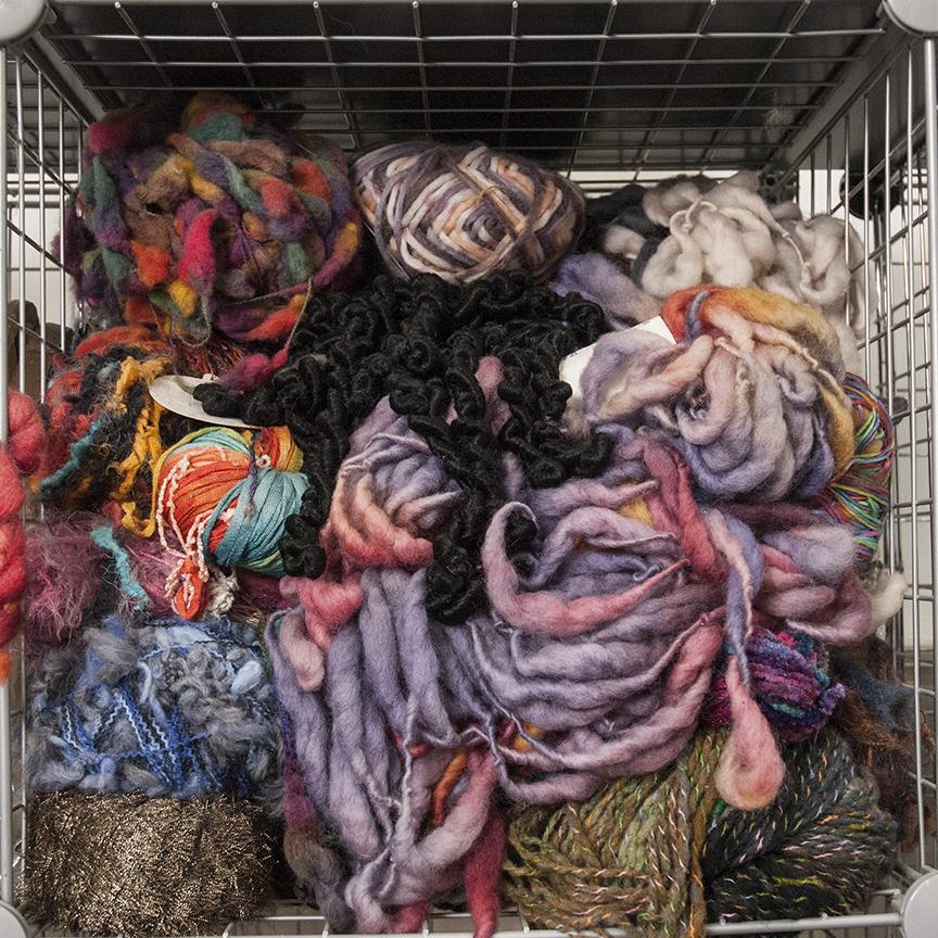 A storage box full of yarn overflows in Gwen Samuels' studio at the Santa Monica Art Studios in Santa Monica, CA. Photo © Aimee Santos