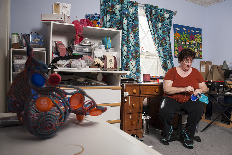 Kornblum works on a piece in one of her many project rooms dedicated to the creation of fiber arts.  Photo © Aimee Santos