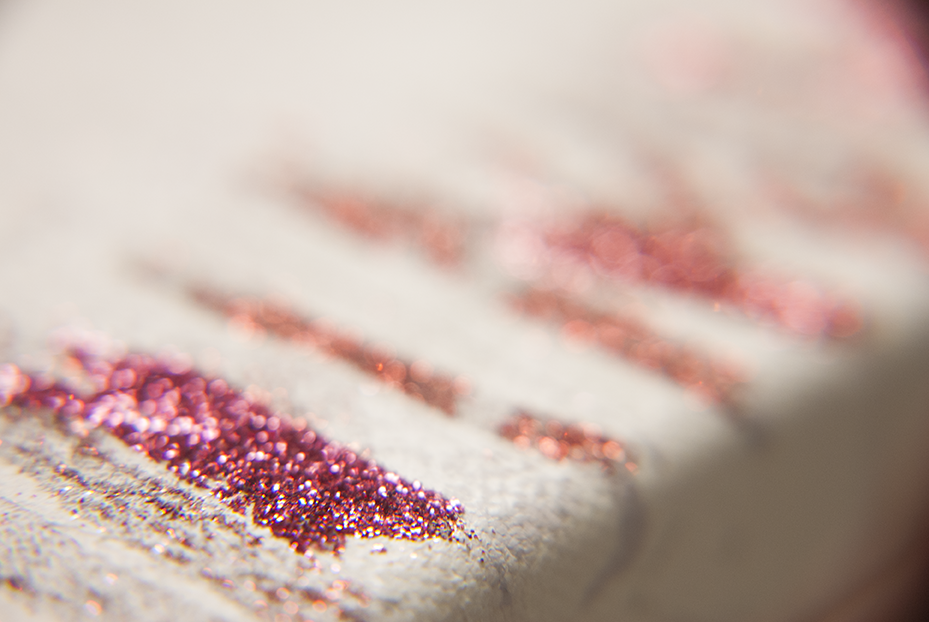 A detail of glitter smears that Irmas wiped off during the application process of glitter on pins, the cleansing palette soon became an artwork of it's own.  Photo © Aimee Santos