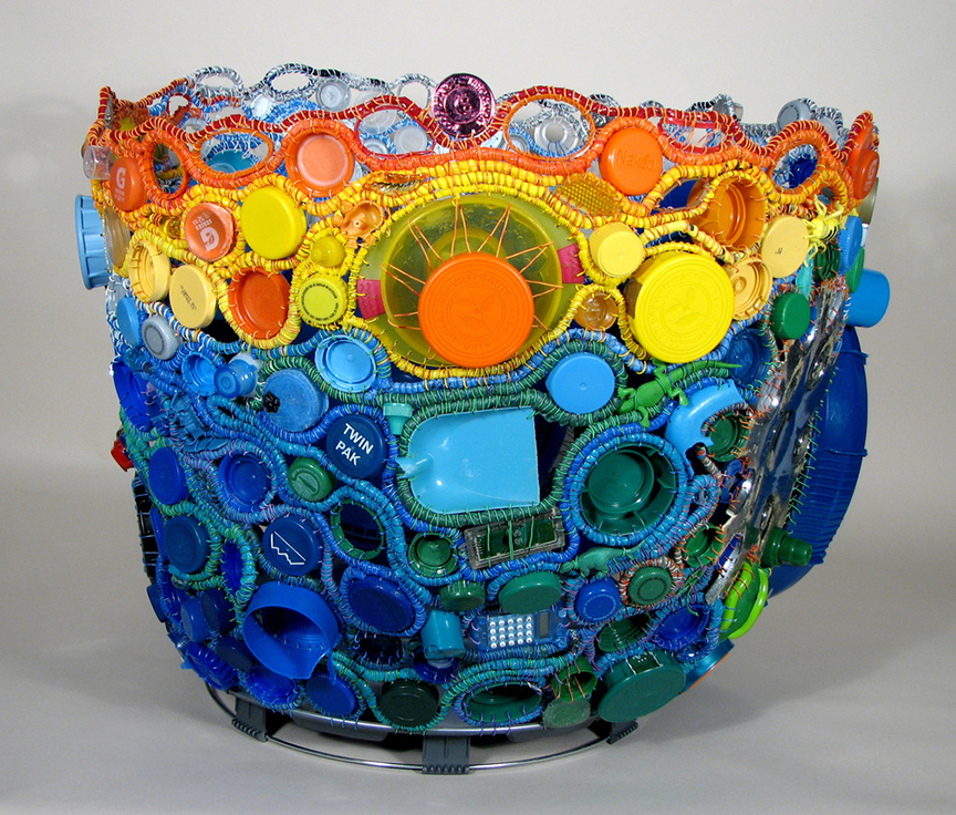 "'Pacific Rim' 20"" x 24"" x 24"" Coiling with used and discarded plastic objects and packaging.  Photo courtesy of the artist."
