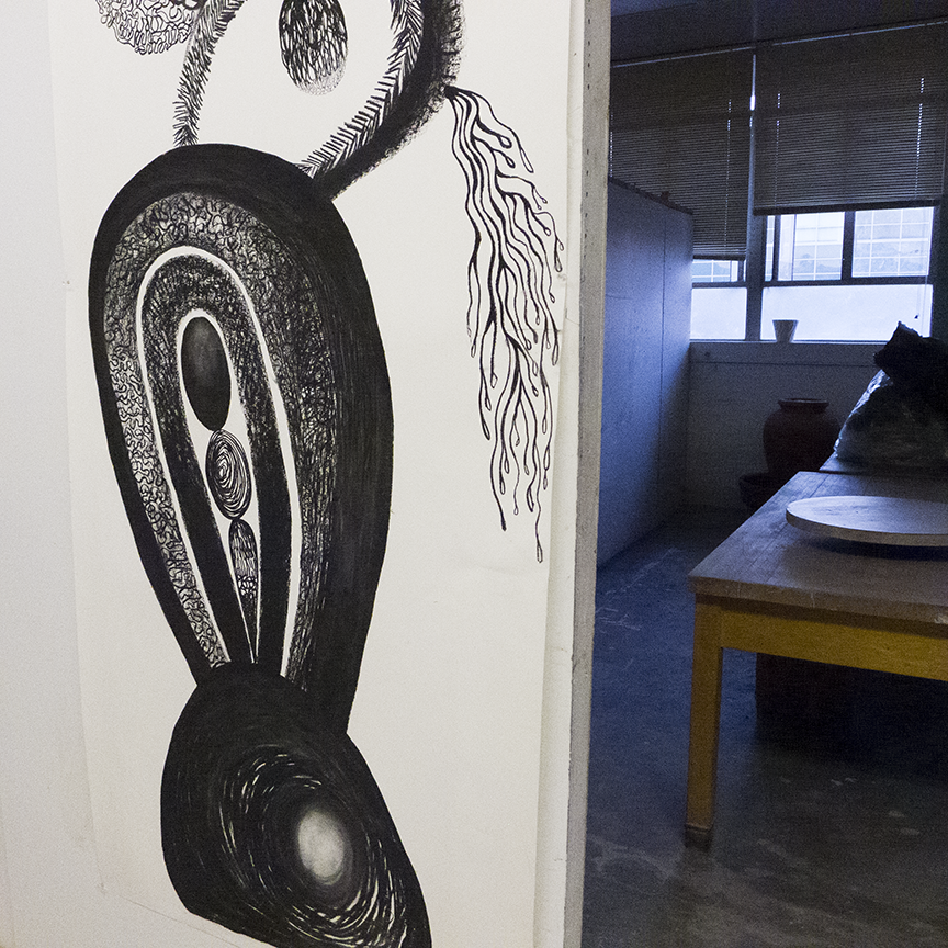 A charcoal drawing by Wride hangs in the hallway of her graduate studio at San Jose State University.  Photo © Aimee Santos