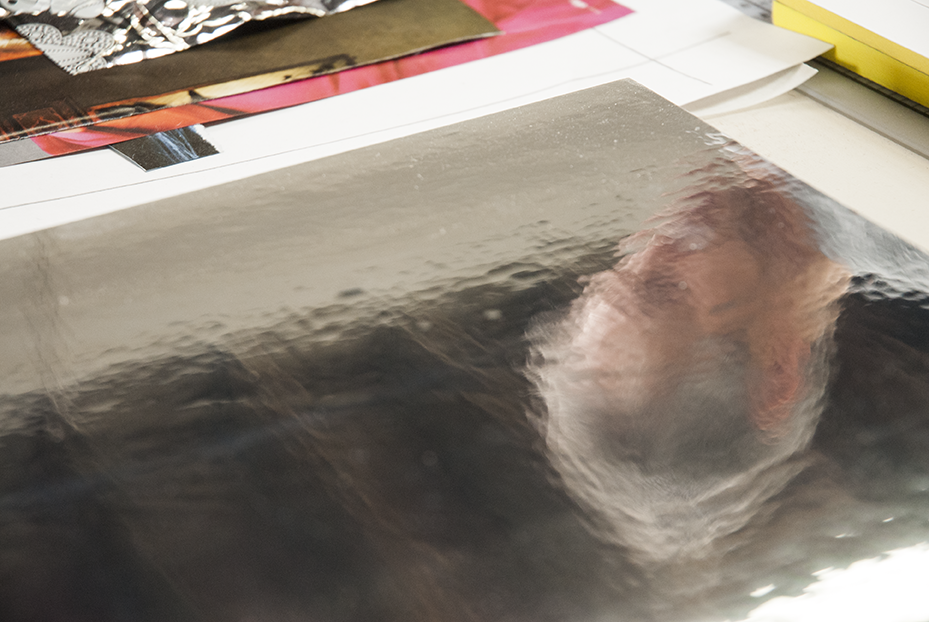 A practice piece of reflective material lays on a table while Gratkowski works on one of many projects. Photo © Aimee Santos