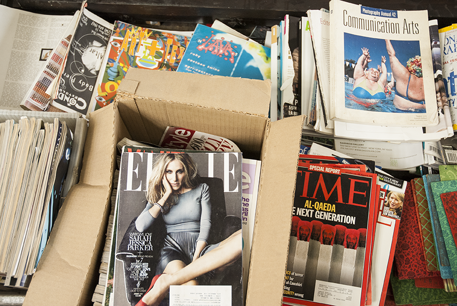 Stacks of magazines lined up next to the wall show a sense of categorization for future usefulness. Photo © Aimee Santos