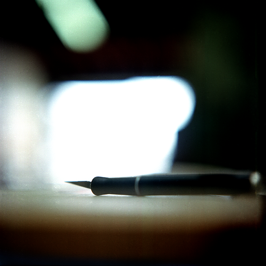 One of Gratkowski's tools, an X-Acto knife, lines the work table where creations are manifested. Photo © Aimee Santos