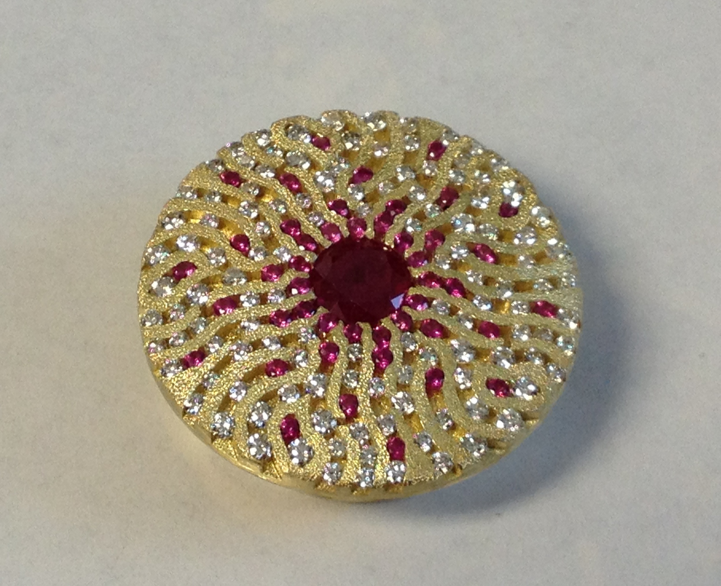 18k Yellow Gold Slide Pendant for a 9.00mm round Burmese Ruby, accented by round full cut 1.30 mm ruby and diamond melee.  Private Collection