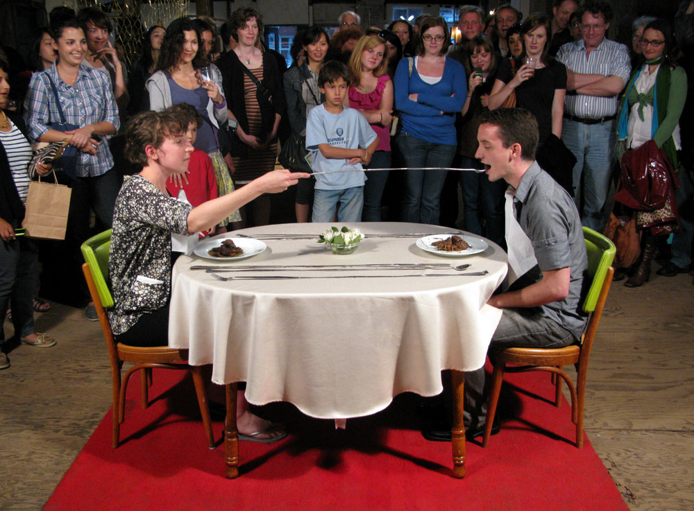 Collaborative Silverware , 2010 Performance and Installation with 1 table, 2 chairs, 2 performer, and 3 feet elongated silverware.