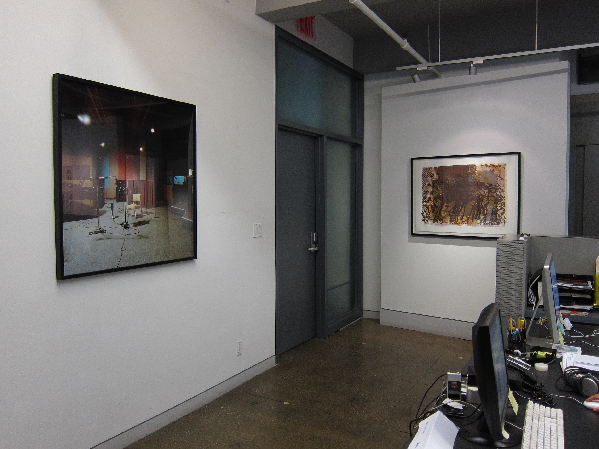 "Office Installation  Left: Rhona Bitner Sam Philips Recording Service, Memphis, TN (from the series Listen) Chromogenic print mounted on aluminum 40"" x 40""  Right: Patricia Leighton Layered Wall 5 color lithograph 35"" x 44.5"" 1996"