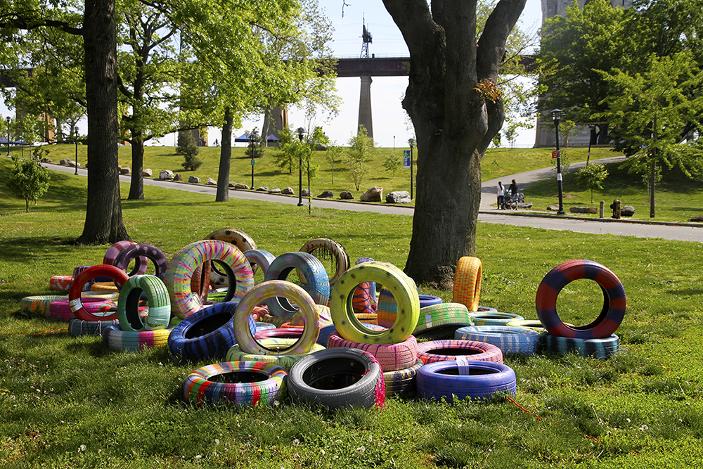 Spartan Follies , 2016 Tires, spray paint, plastidip paint, paracord rope, fitness balls, sand, chains, bolts and duct tape. Variable dimensions. Public artwork for FLOW.16 in Randall's Island Park, NYC.