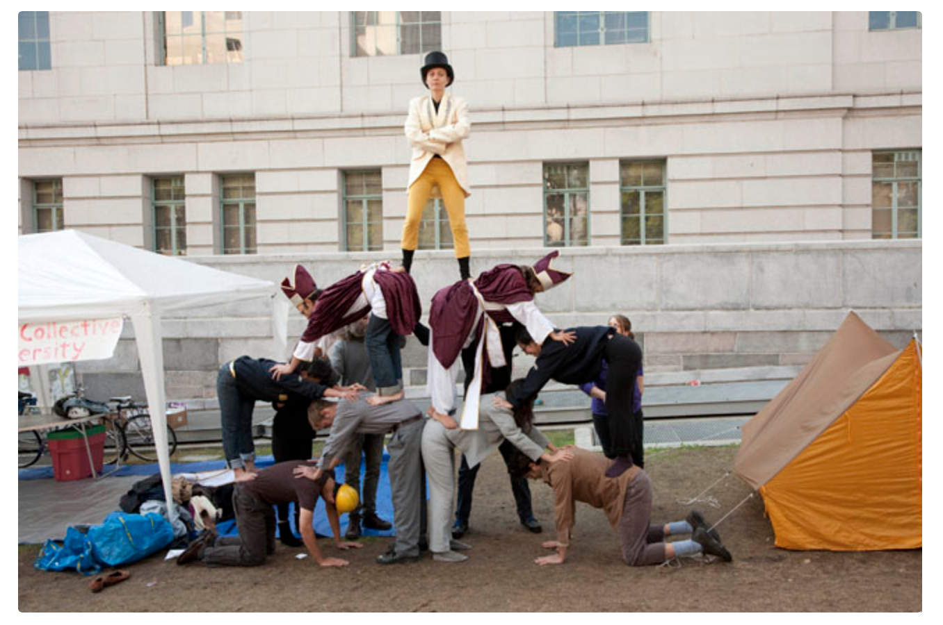Robby Herbst, Pyramid of Capitalist System, 2011. Performance at LA City Hall during Occupation 10/11. Photo: Lisa Anne Auerbach