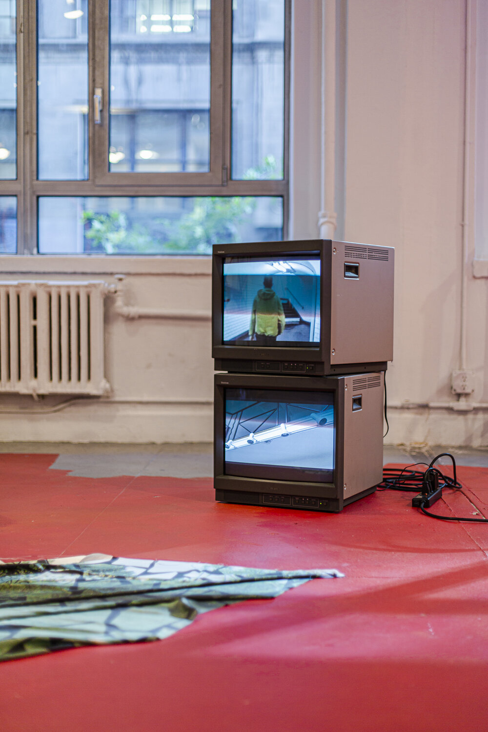 Nicholas Vargelis,  Prise, Interrupteur, Douille , incandescent bulbs, bent electrical pipe, incandescent colored bulbs, outlet, switches, cable, two video cube monitors, video loops, dimensions vary, 2019.   Laetitia Badaut Haussman,  The Silk Prints , 4 Posters, Inkjet on Silk, 55 x 67 in. each, 2019.  Flora Moscovici,  Hula hoop Chack Chack , latex paint on floor, approx. 25 x 40 ft., 2019.