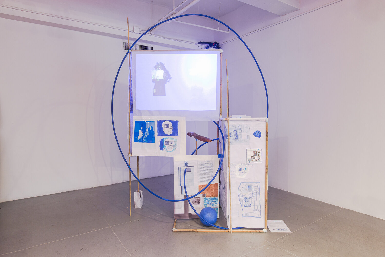 A Constructed World with Stephanie Lin,  Fragment:01 (Live Eels) , bamboo, film projection on paper screen, epoxy putty, hula hoop, copper, paper, various objects, 6.5ft h x 5ft w x 3ft d, 2019.