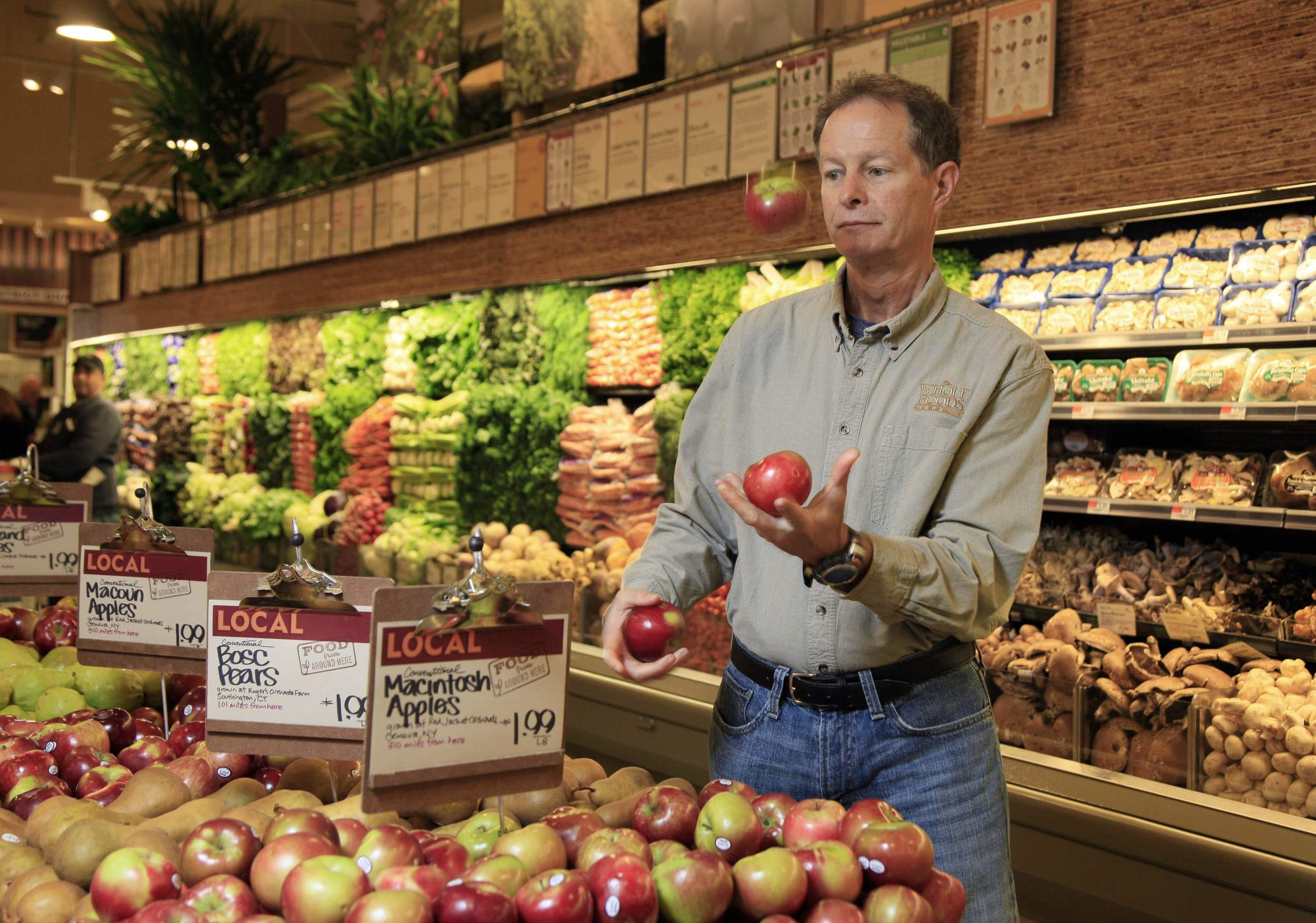 Whole Foods: A work of art in many ways. Founder John Mackie juggling the fruit in the museum of fresh produce.