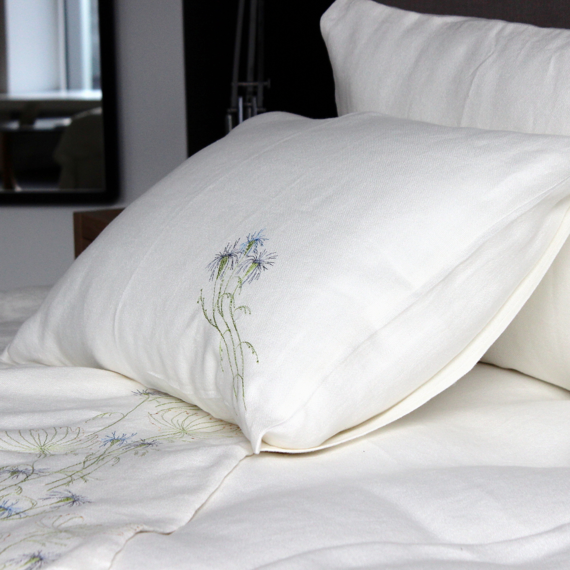 Embroidered bed linen.