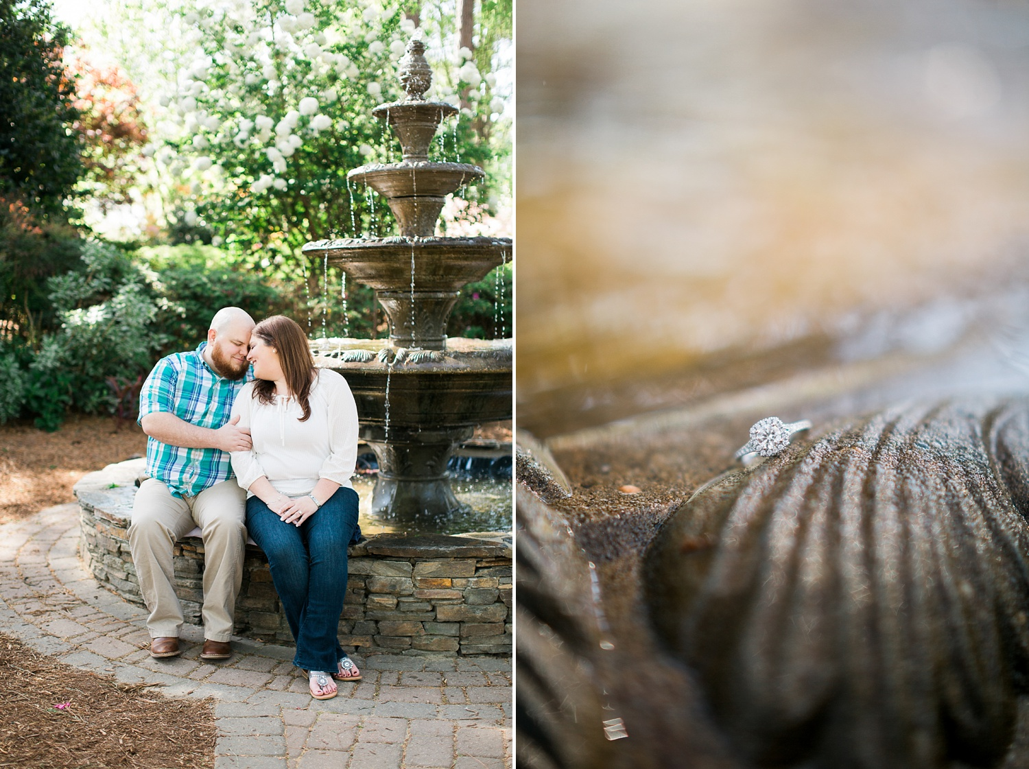 couple sits on the edge of a water fountain in a garden