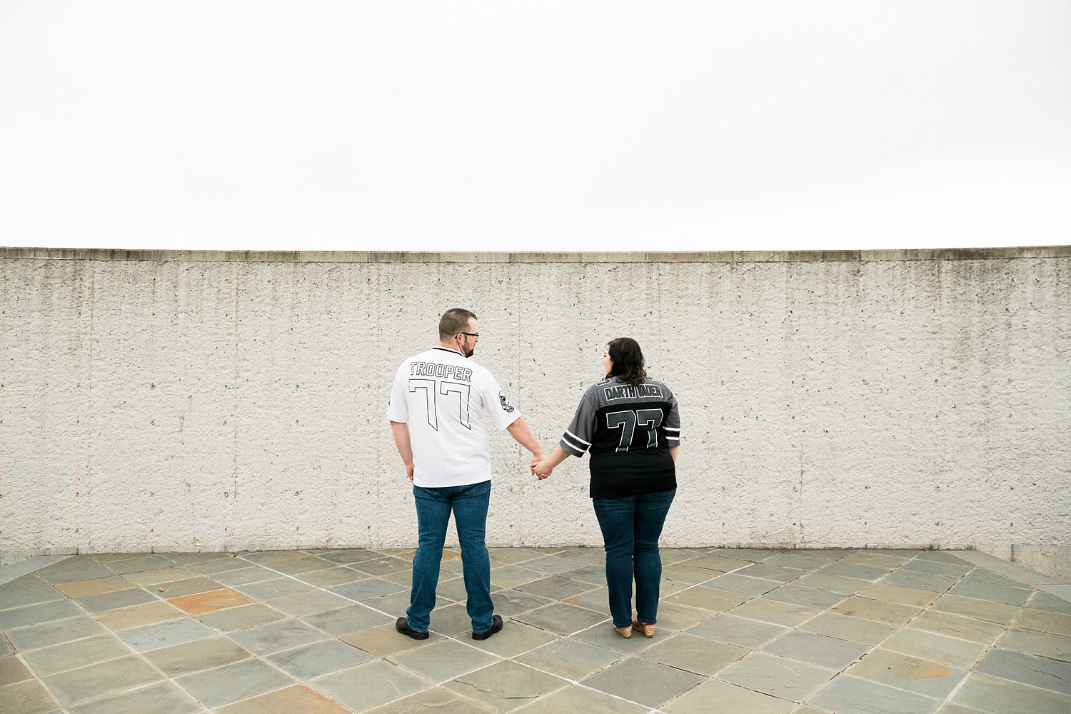 couple wears star wars jerseys for their engagement session