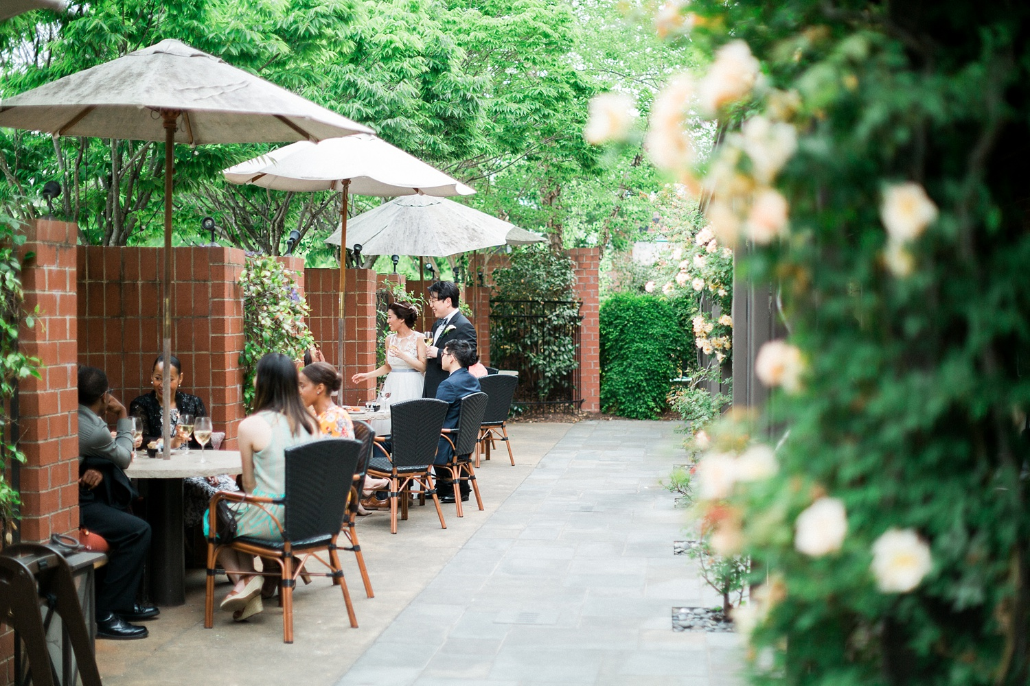 bride and groom mingle with guests at their weathervane restaurant patio reception