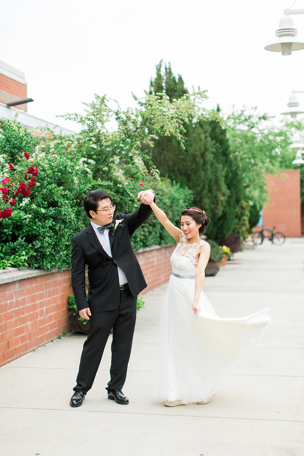 groom twirls bride on their wedding day