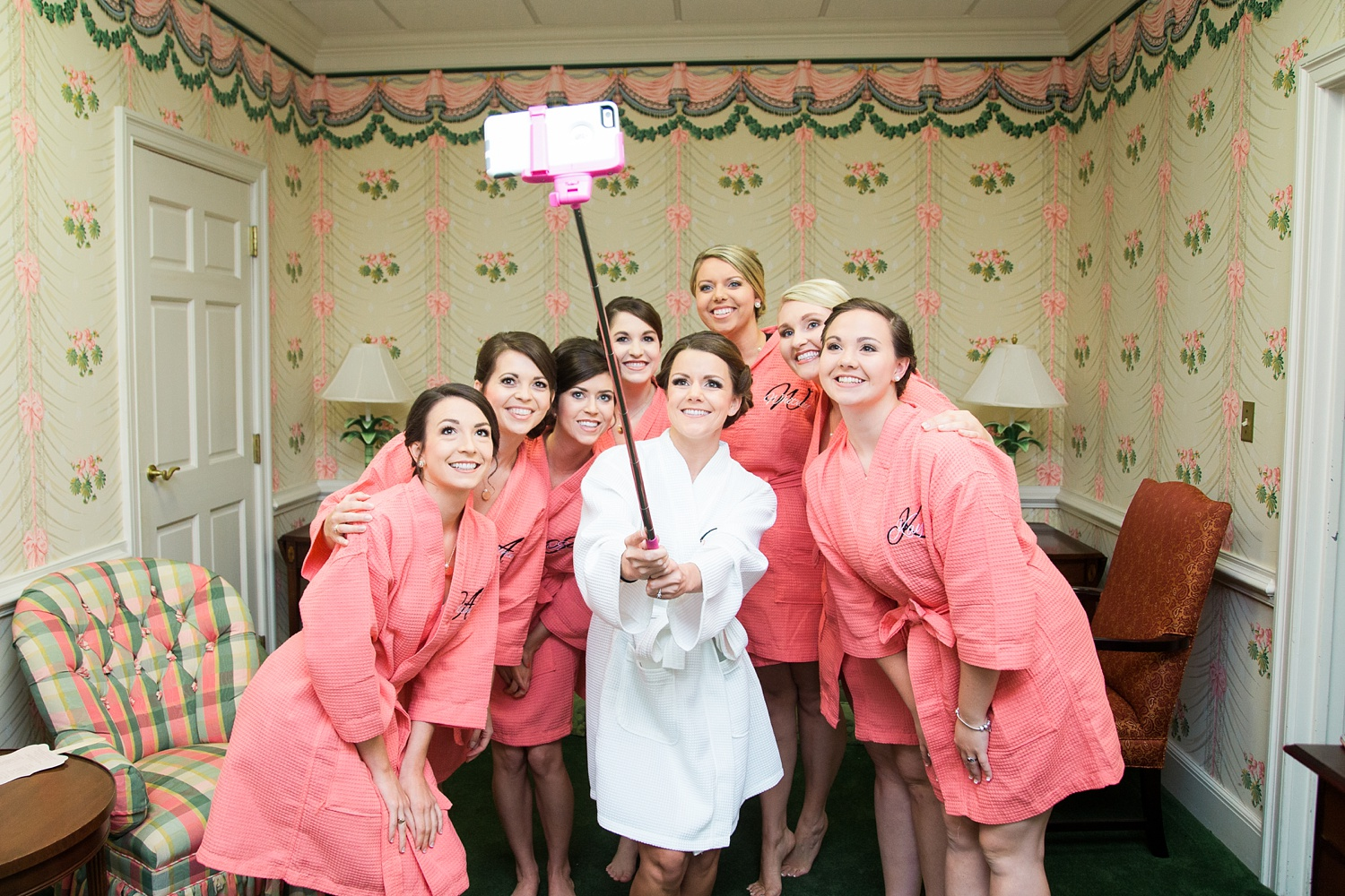 bridal party takes a selfie in the bridal suite at chatmoss country club