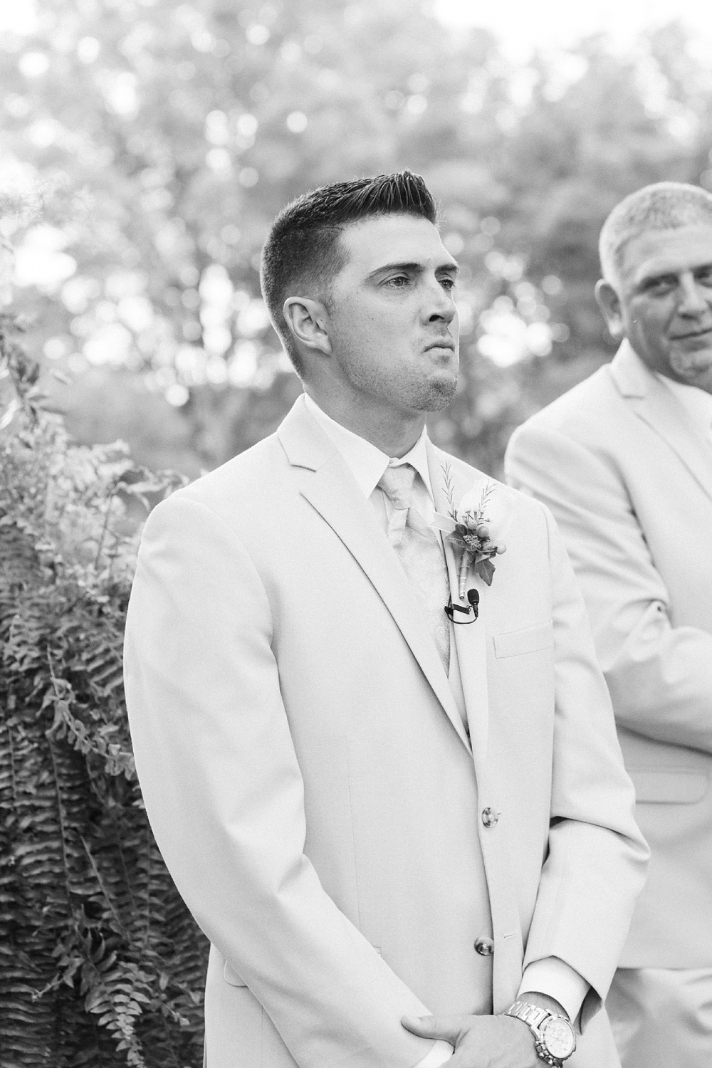 groom cries as he sees his bride coming down the aisle