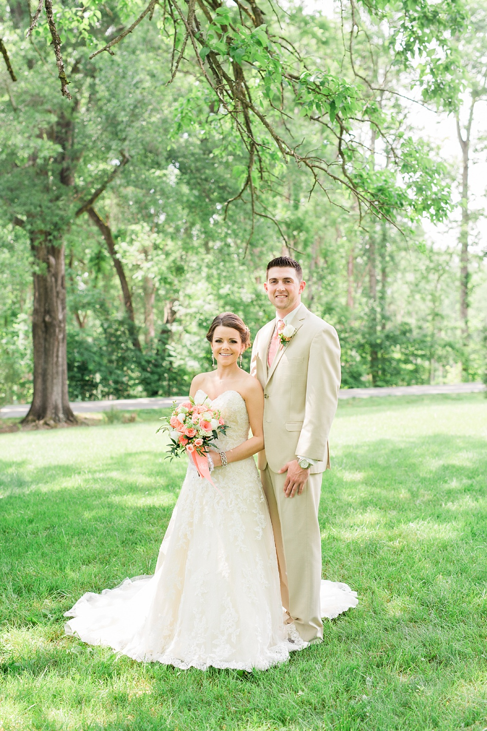bride and groom on the lawns at chatmoss country club