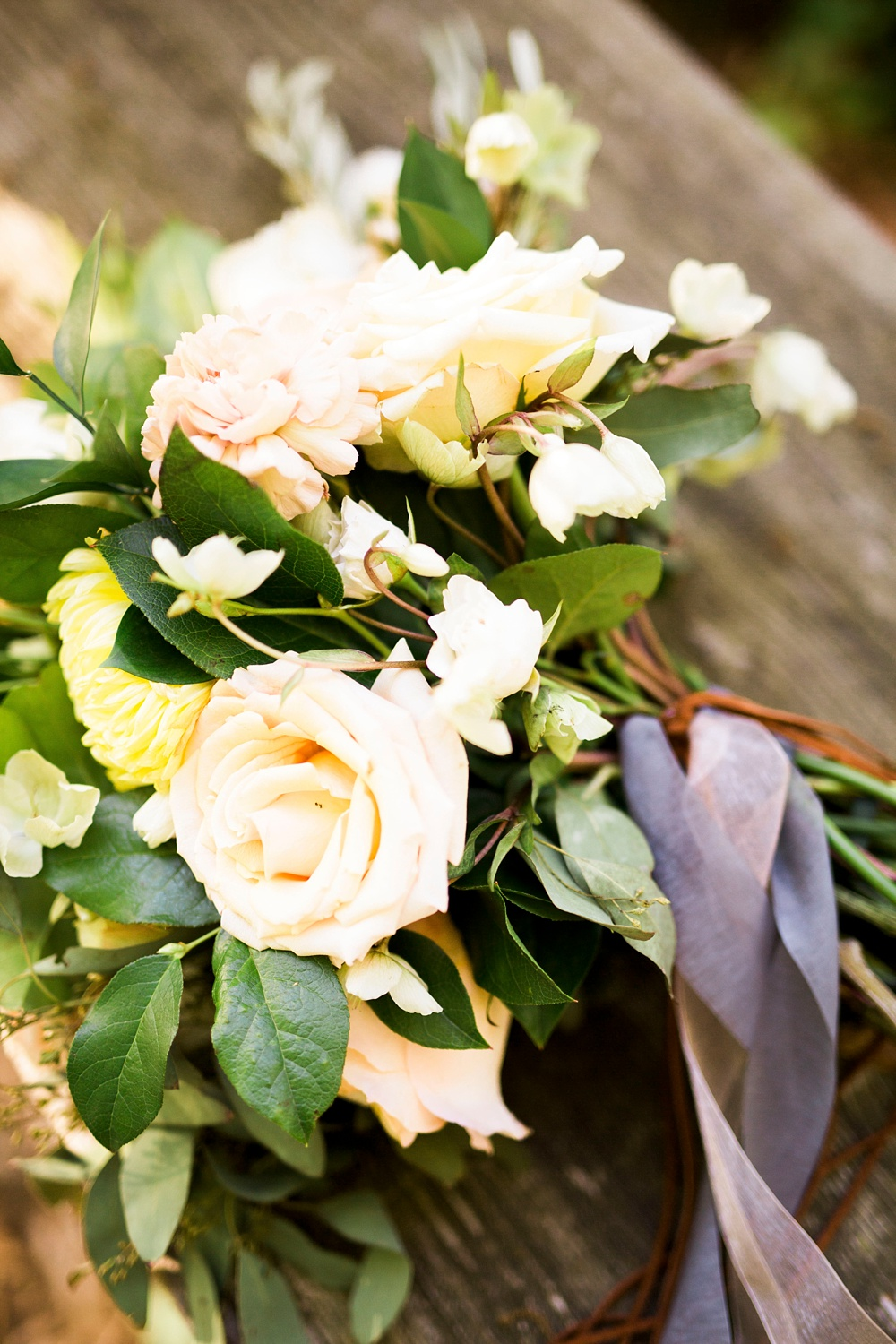 boho bridal bouquet on a aged wooden bench