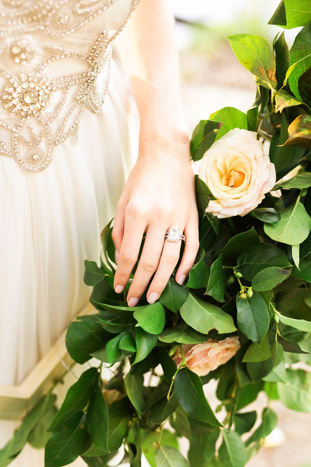 bride's hand resting on a floral bunch