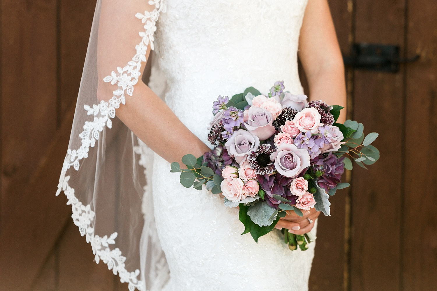 bride holds her rose bouquet