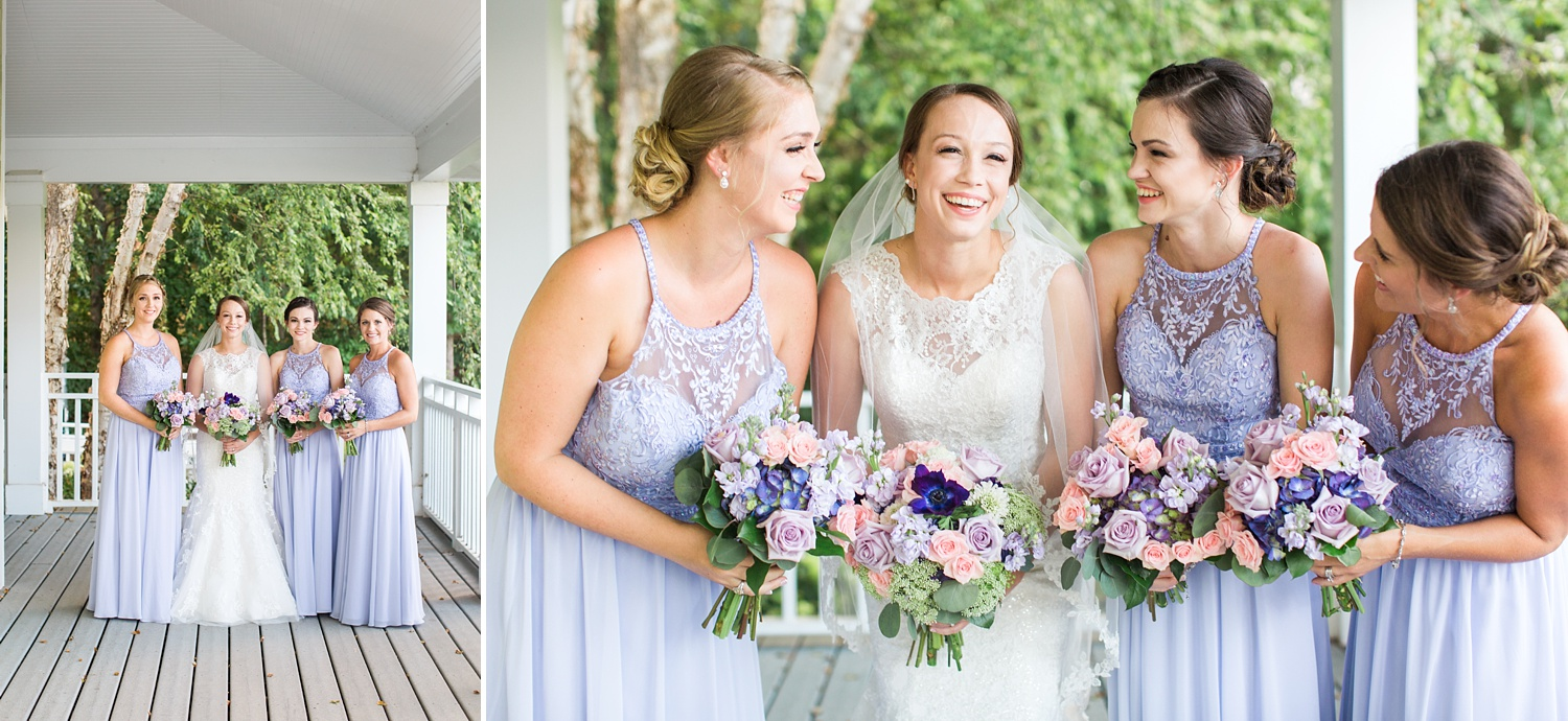 bridal party poses on a wrap around deck