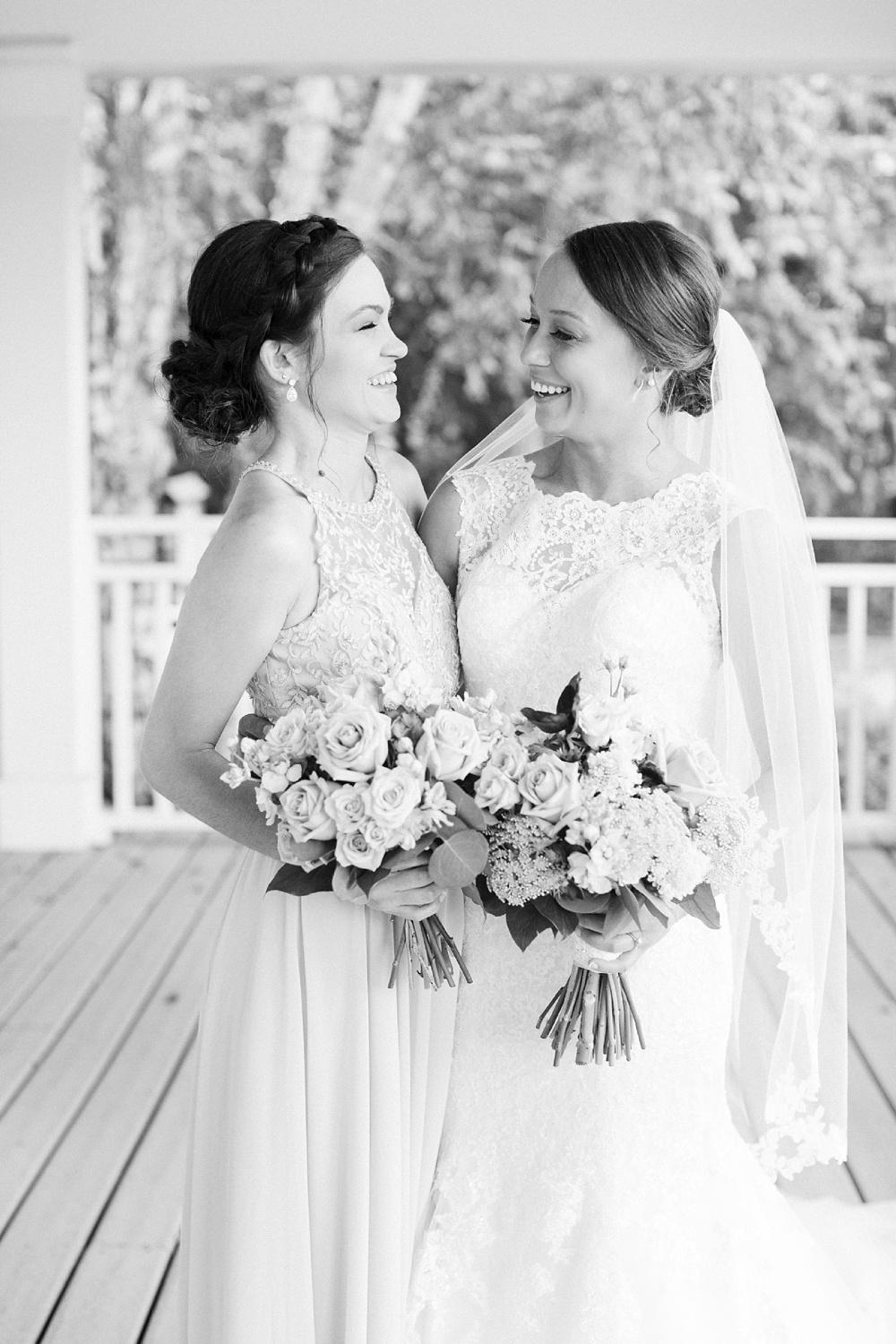 bride and her sister smile at each other
